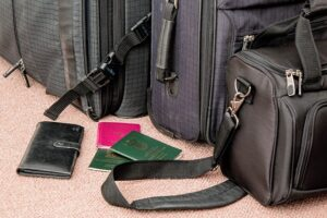 Bags, passports and a wallet on the floor